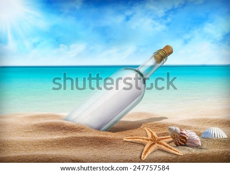 Bottle with a message for help. Sea beach. - stock photo