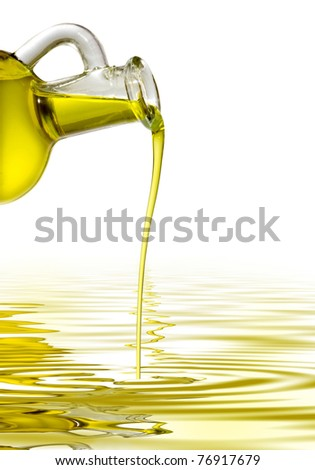 Bottle with a thread of olive oil - stock photo