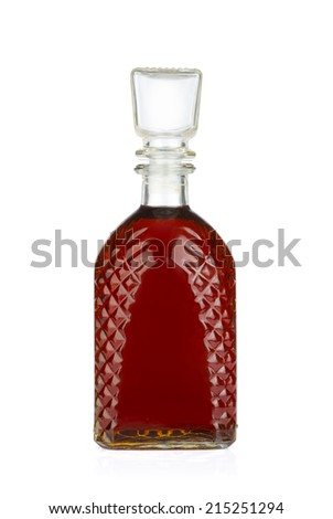 Bottle with brandy isolated on white background.