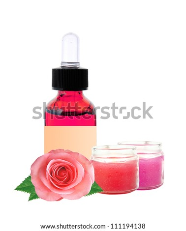 bottle with essence oil and rose flowers isolated on white