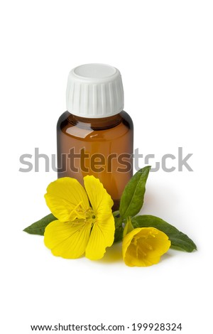 Bottle with  Evening Primrose oil and fresh flower on white background - stock photo