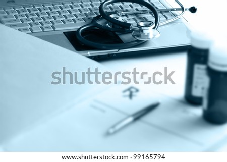 bottle with laptop - stock photo