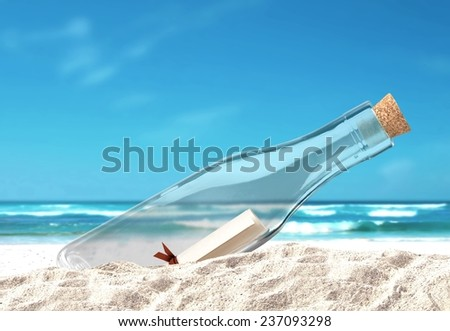 Bottle with Message in the Sand - stock photo