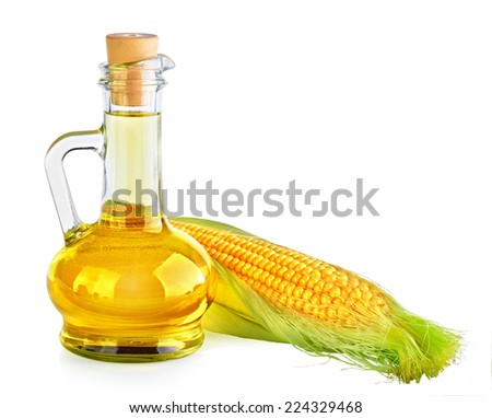 Bottle with oil and a corncob. On white background. - stock photo