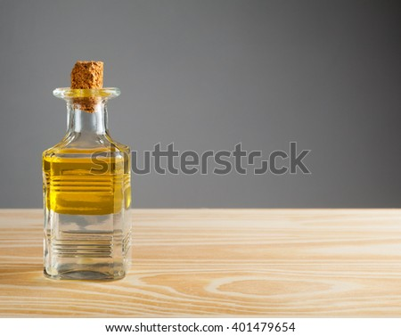 Bottle with oil and water. - stock photo