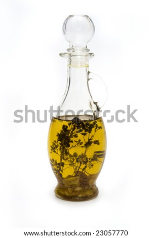 Bottle with olive oil and spices isolated on white