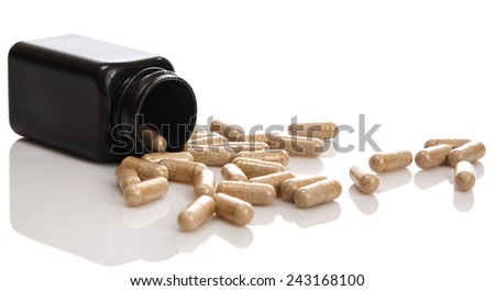 Bottle with pills over white background - stock photo