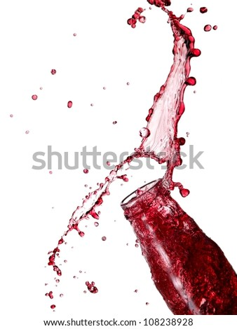 Bottle with red juice splash with drops - stock photo