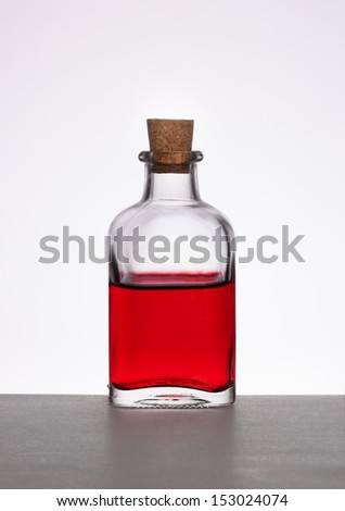 bottle with red liquid - stock photo