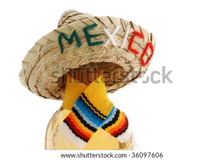 Bottle with shawl and Mexico hat, isolated on white. - stock photo