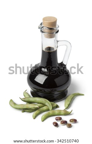 Bottle with soy sauce and fresh soybeans on white background - stock photo