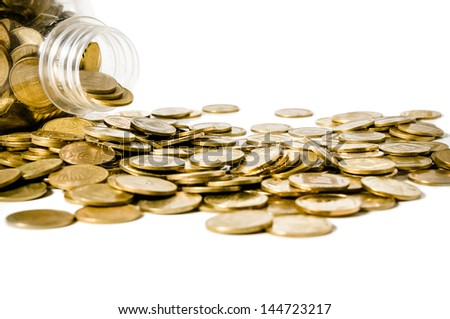 Bottle with the scattered coins on the white background