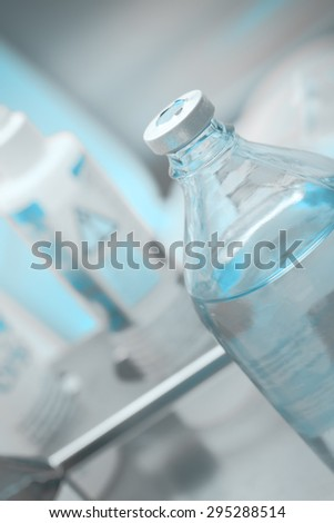 Bottle with the solution on procedural table in hospital