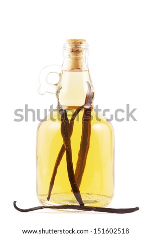 Bottle with vanilla liqueur or essence on white - stock photo