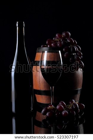 Bottle with vine on black background