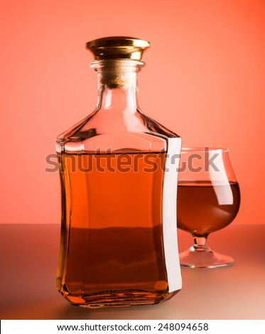 Bottle with whiskey on glass background - stock photo
