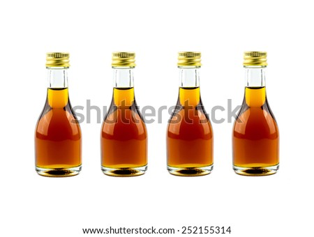 Bottle with whisky on white background - stock photo