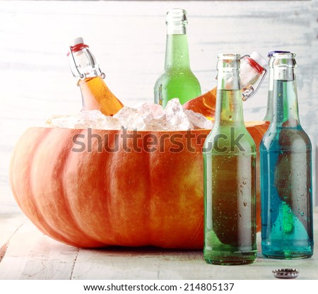 Bottled Beverages Chilling in Pumpkin Ice Bucket