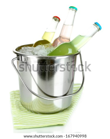 Bottled drinks in ice bucket isolated on white