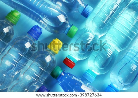 Bottled water on the blue background,top view - stock photo