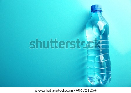 Bottled water on the blue background, top view - stock photo