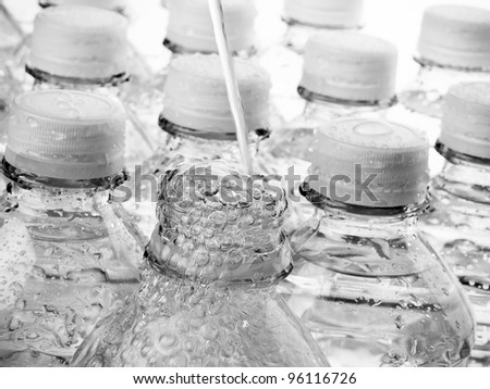 Bottled Water streams and bubbles from the spout - stock photo