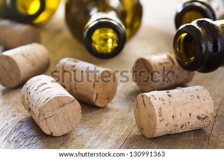bottles and corks on wooden table