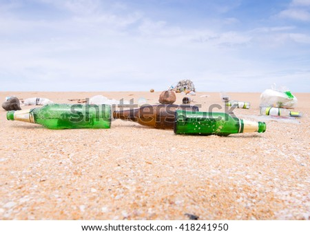 bottles and garbage waste on the beach