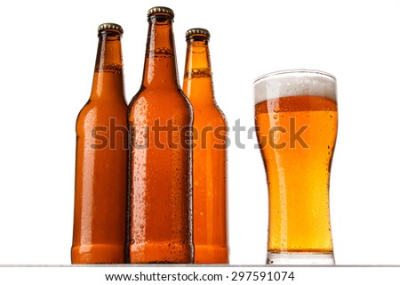 Bottles and glass of beer over white background - stock photo