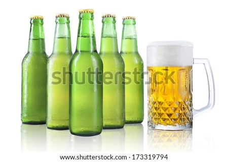 Bottles and glass of beer with drops isolated on white background - stock photo