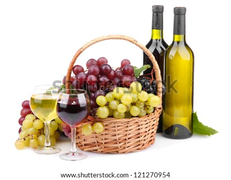 bottles and glasses of wine and grapes in basket, isolated on white
