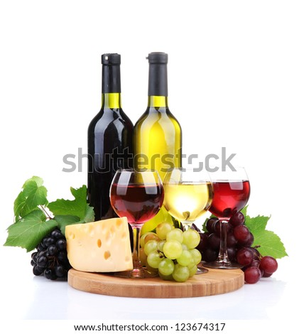bottles and glasses of wine, assortment of grapes and cheese isolated on white