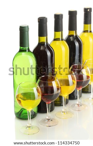bottles and glasses of wine isolated on white - stock photo