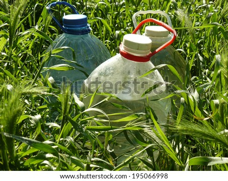bottles filled up with artesian water - stock photo