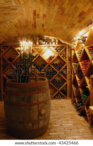Bottles in an old wine-cellar - stock photo