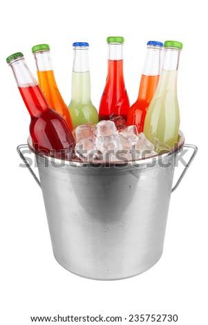 bottles in ice isolated on white background  - stock photo
