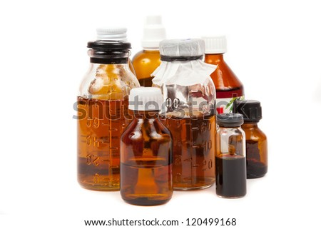 bottles medical with a potion on a white background - stock photo