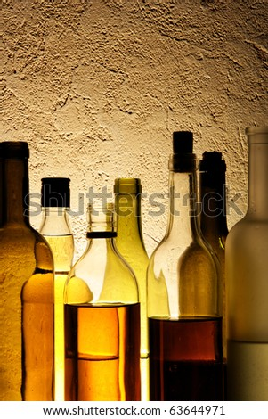 Bottles of alcohol drinks in a bar - stock photo