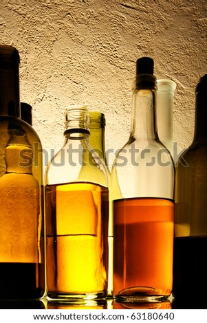 Bottles of alcohol drinks in a row - stock photo