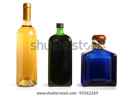 Bottles of alcoholic drinks on a white background - stock photo