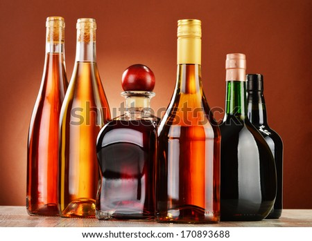 Bottles of assorted alcoholic beverages - stock photo