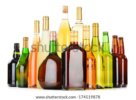 Bottles of assorted alcoholic beverages isolated on white background - stock photo