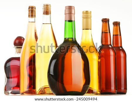 Bottles of assorted alcoholic beverages isolated on white background