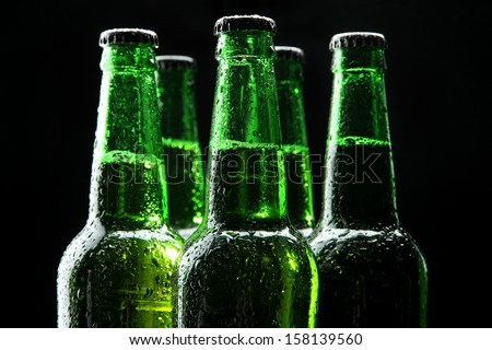 Bottles of beer on black background - stock photo