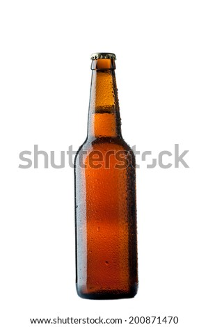 Bottles of beer with drops on white background.