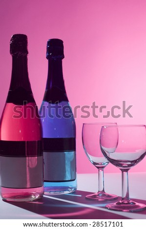 Bottles of beverage and glasses