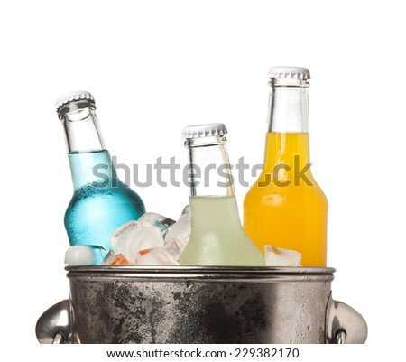 Bottles of colorful soda and ice in a bucket isolated on white background  - stock photo