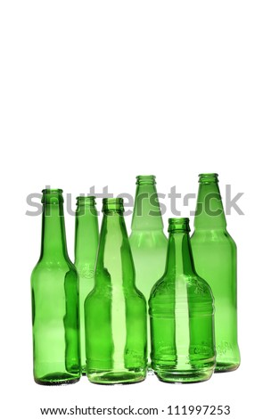 bottles of different size over white background