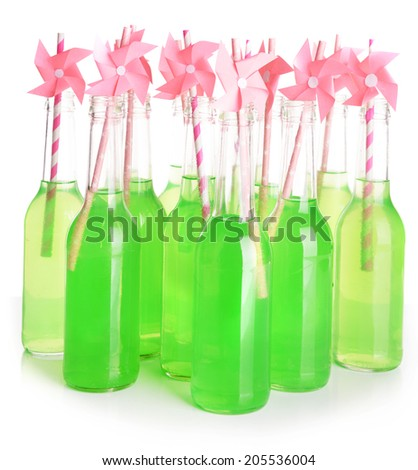 Bottles of drink with straw on light background - stock photo