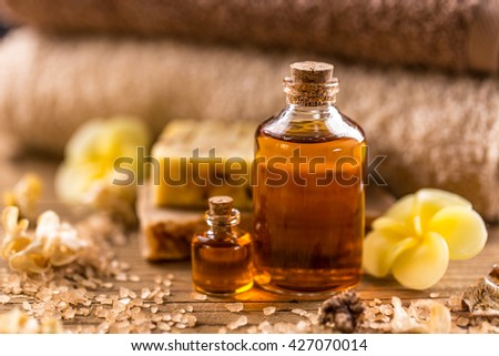 Bottles of essential aroma oil on wooden board